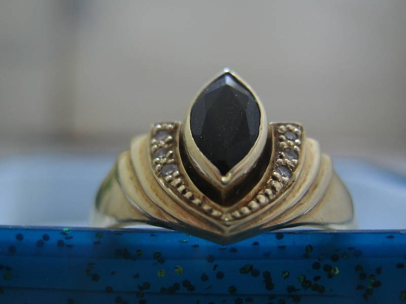 Designer ring with gemstone