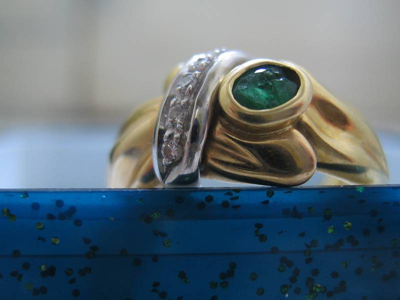 Designed ring with broken gemstone and diamonds