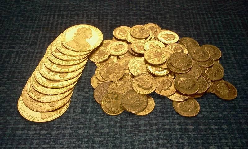 Austrian ducats on a pile
