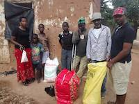 Laurence at Upendo orphanage, delivery of clothes and shoes