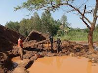 Miners processing tailing in Uganda