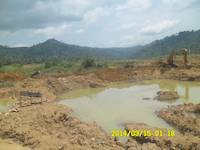 The soagum gold washing plant and excavator on the mining site in Ghana