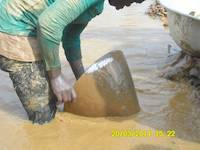 Miner panning for gold