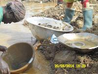 Miners panning for gold in Ghana