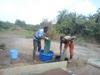Mr. Okedi and Mr. Wabwire collecting the gold concentrate in Uganda