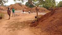 Children panning for gold on mining site
